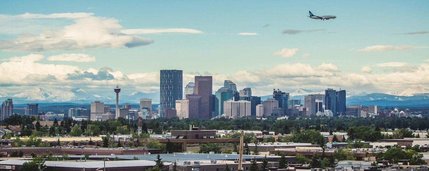 Calgary skyline with airplane over downtown