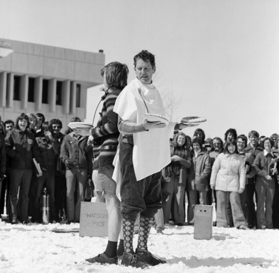 A.W.R. Carrothers, president of the University of Calgary, preparing to have a pie duel with the Students' Union president.
