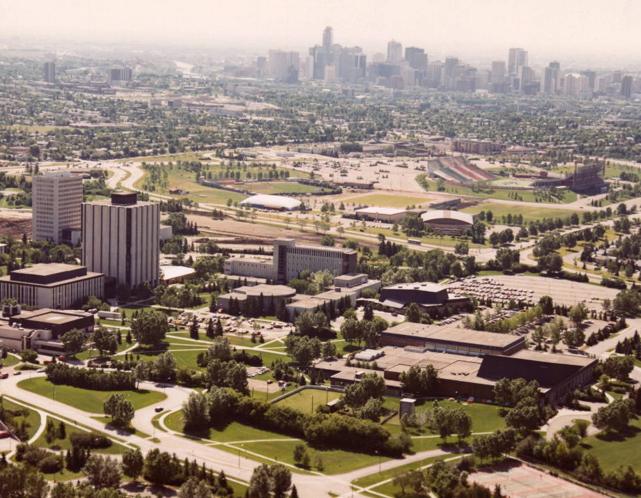Image of an aerial view of the University of Calgary campus looking south towards downtown Calgary  with Physical Education in the foreground and MacEwan Hall in the foreground.