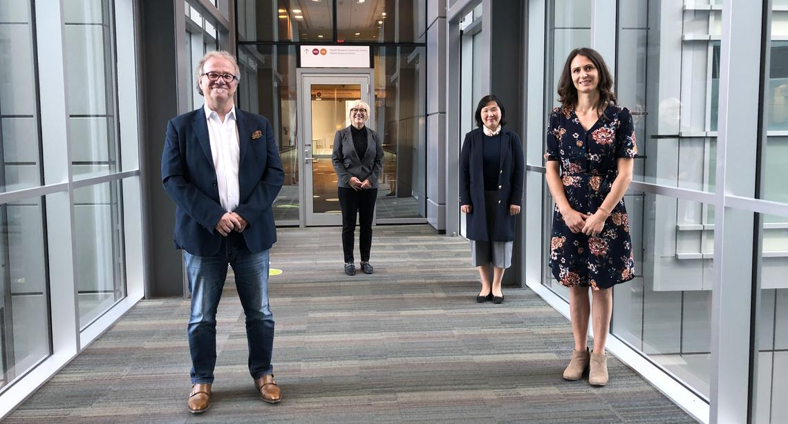 Members of the UCalgary research team that discovered a way to stop the growth of glioblastoma, the deadliest form of brain cancer.