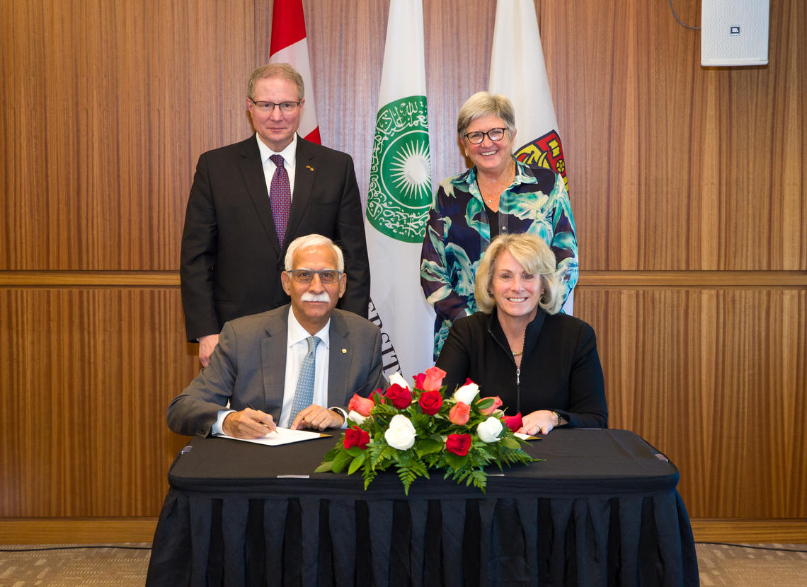 Signing a Memorandum of Understanding on Oct. 17, 2018 between the University of Calgary and the Aga Khan University.