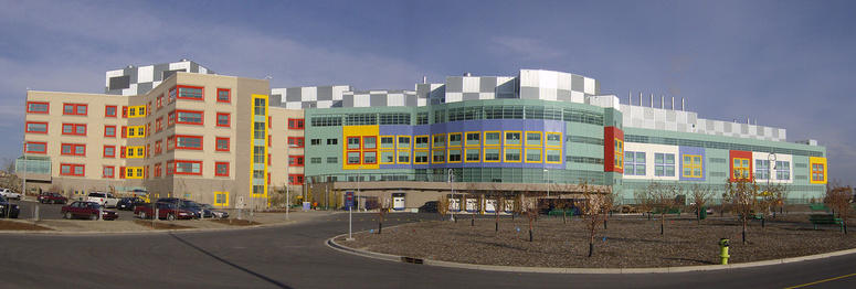CIHR grant name: Evaluating Innovations in Transition to Adult Care: Transition Navigator Trial. Photo of Alberta Children's Hospital by Robert Thivierge, stitched by Qyd, licensed under Wikimedia Commons
