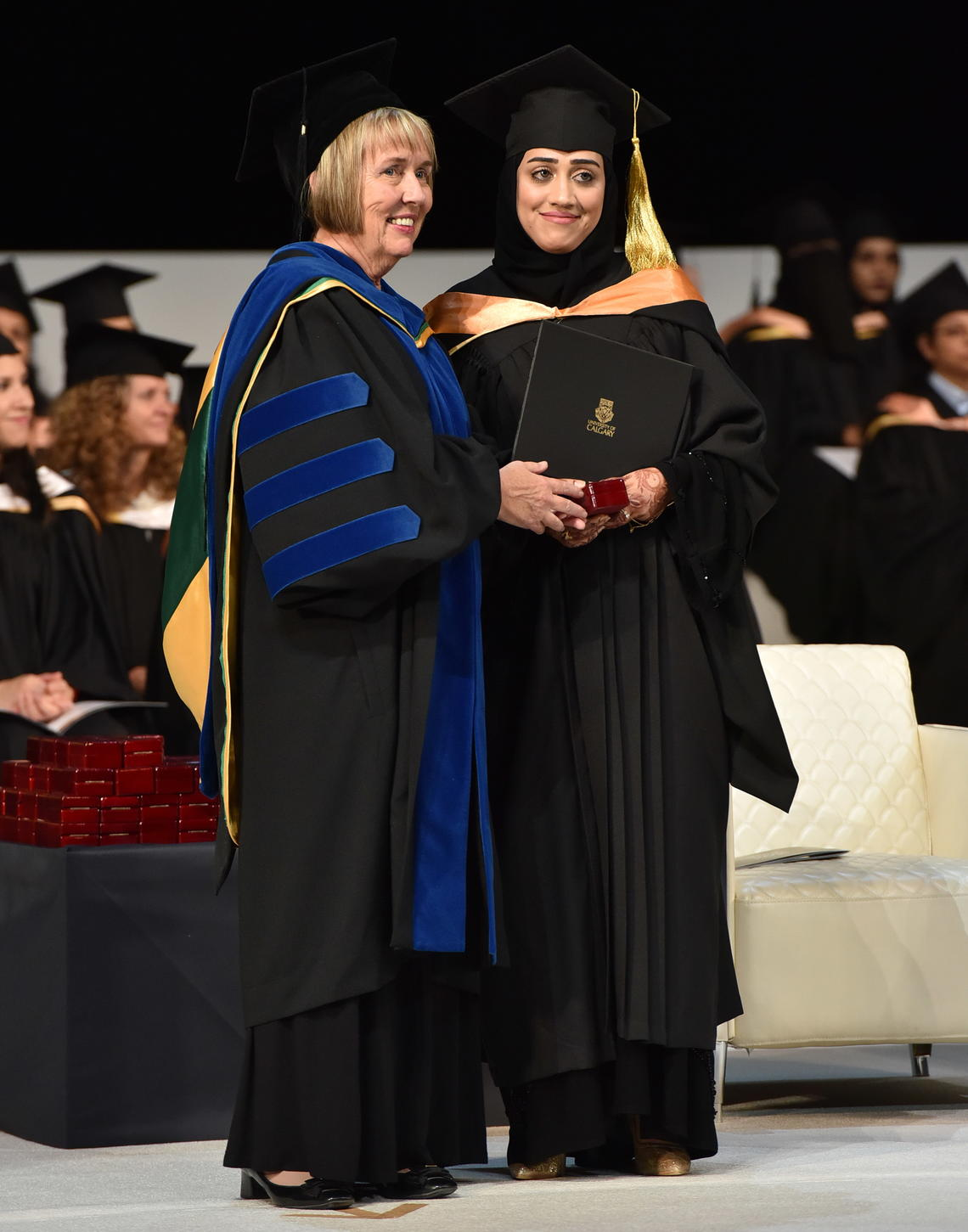 Dean Deborah White with a graduating student at the May 13 convocation ceremonies in Qatar.