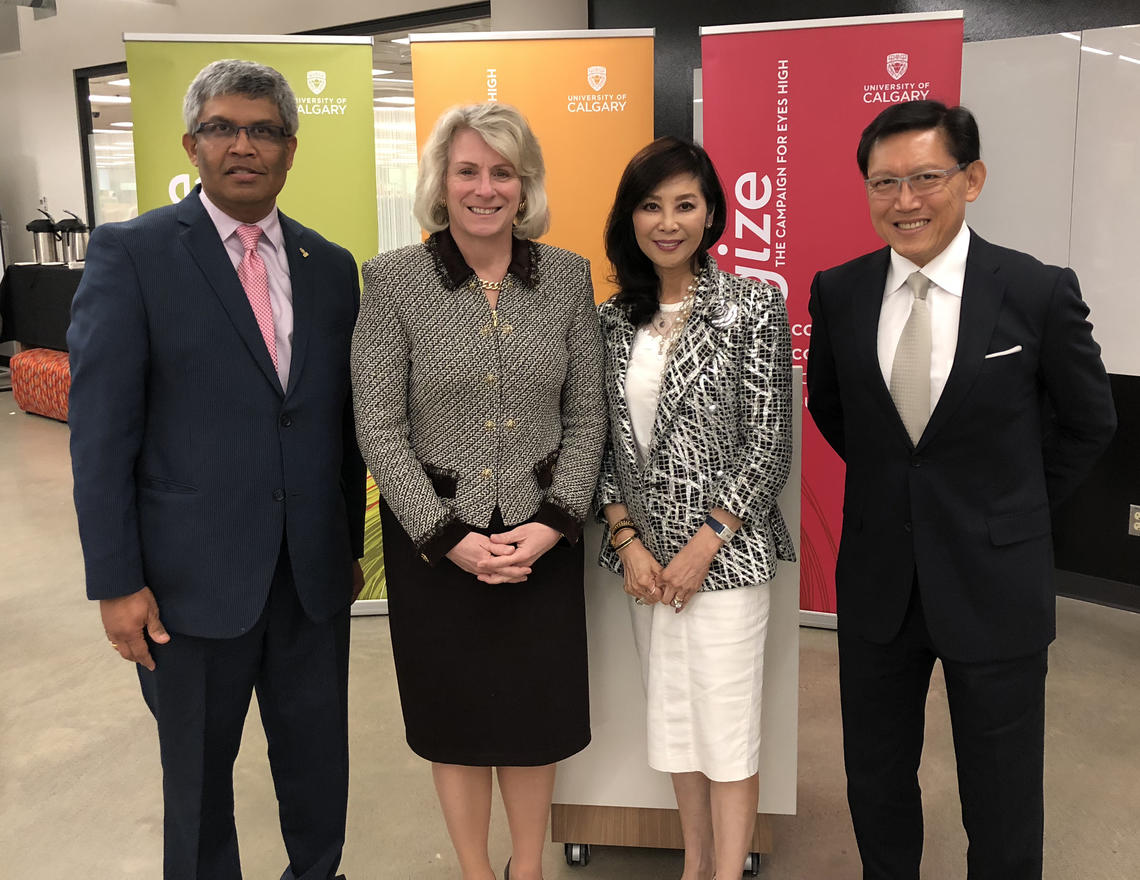 University of Calgary President Elizabeth Cannon, second from left, with  Vice-Provost (International) Janaka Ruwanpura, left, and major donors Cindy and Joseph Leung.