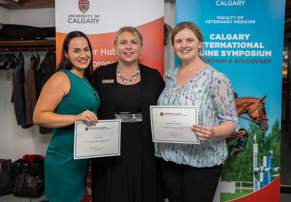 Top graduate student poster winners Carina Cooper, left, from Ontario Veterinary College, and Sian Durward-Akhurst from the University of Minnesota are congratulated by sponsor Joelle Foster, executive director of the Hunter Hub for Entrepreneurial Thinking.