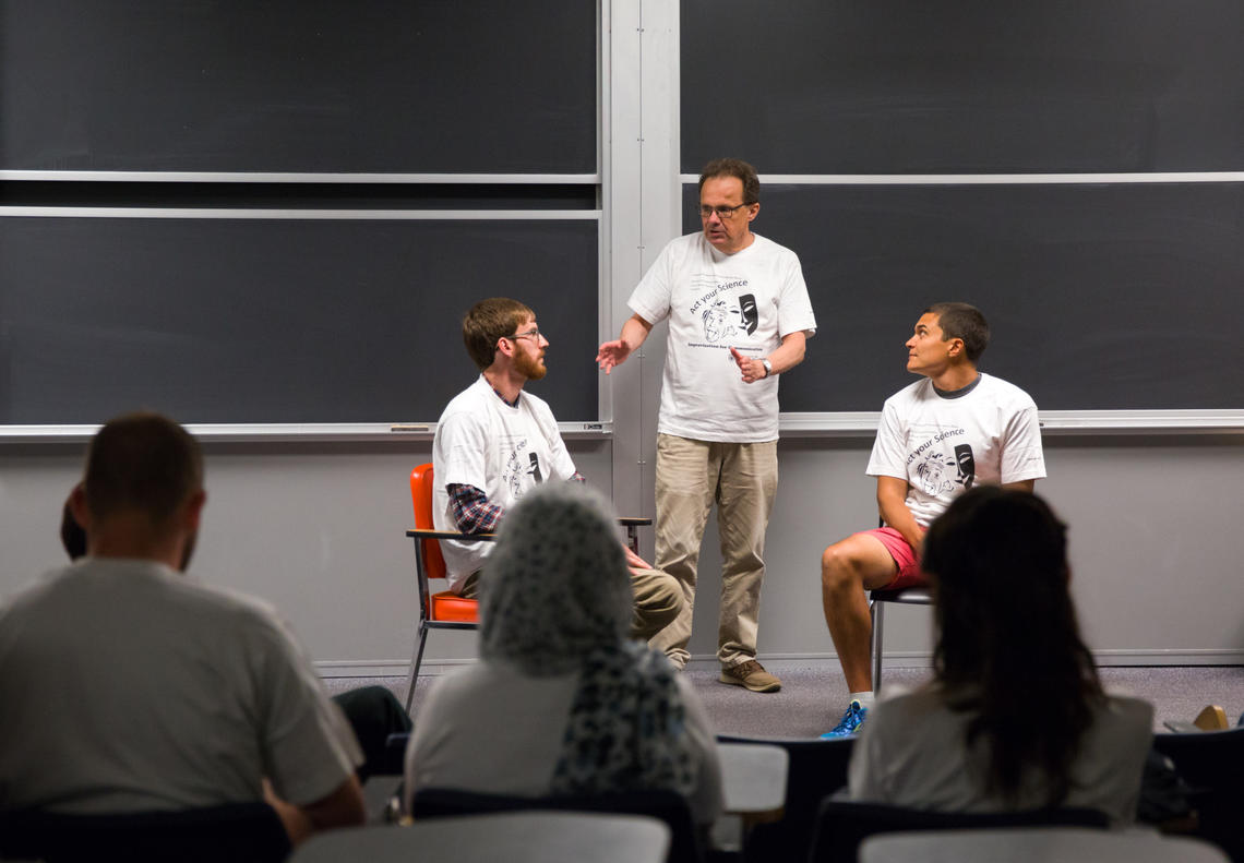 Dennis Cahill, centre, teaches science and technology students foundational skills for improvisation to improve their public speaking and science communication skills at the Act Your Science workshop. With him are students David Garett, left, and Andres Kroker.