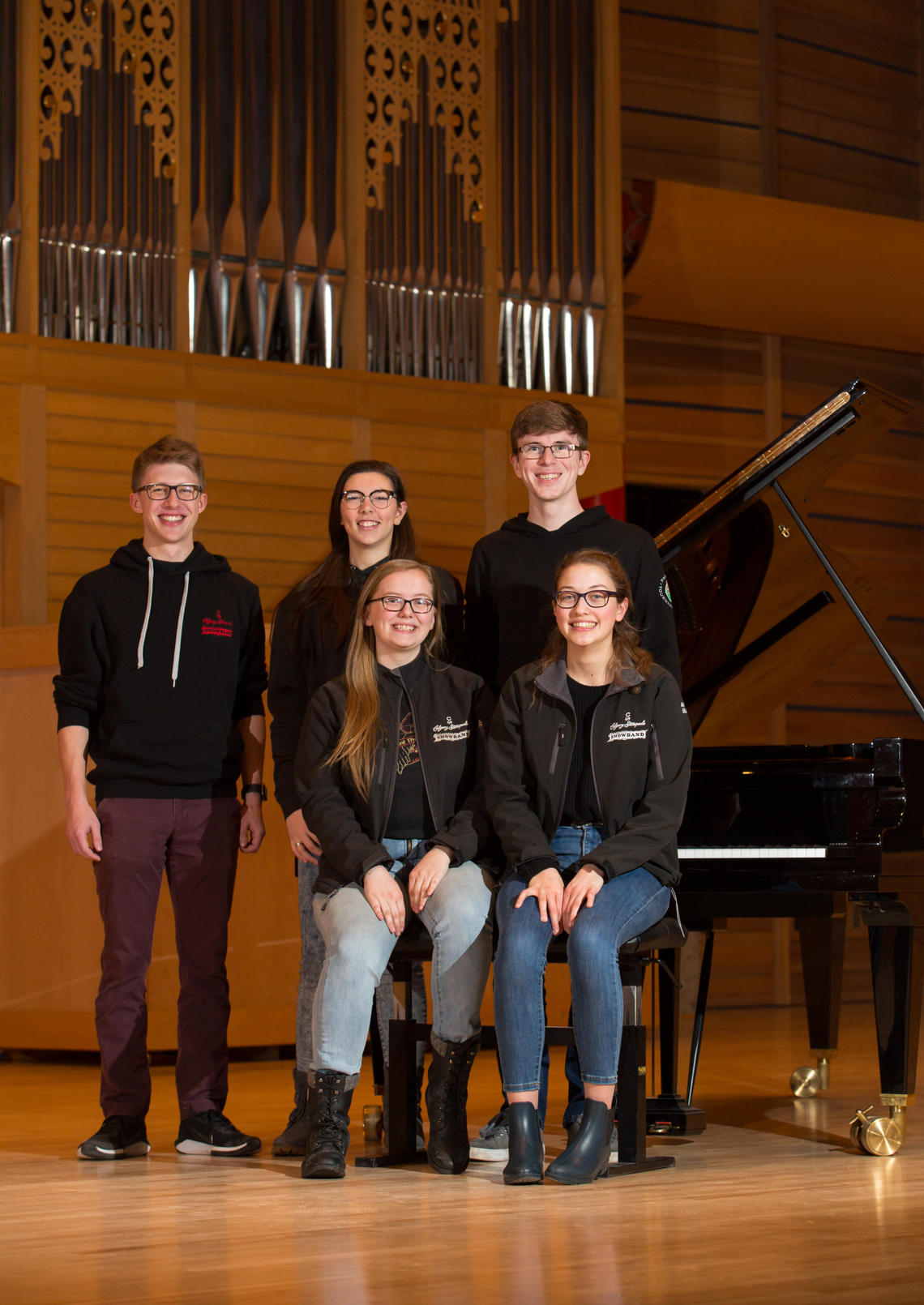 Among University of Calgary students taking part in the upcoming Alberta International Band Festival on campus are, standing, from left: Connor Beatty, Renee Thoutenhoofd, and Ethan Toblan. Seated, from left: Jessica Silbernagel and Anna Carlson.