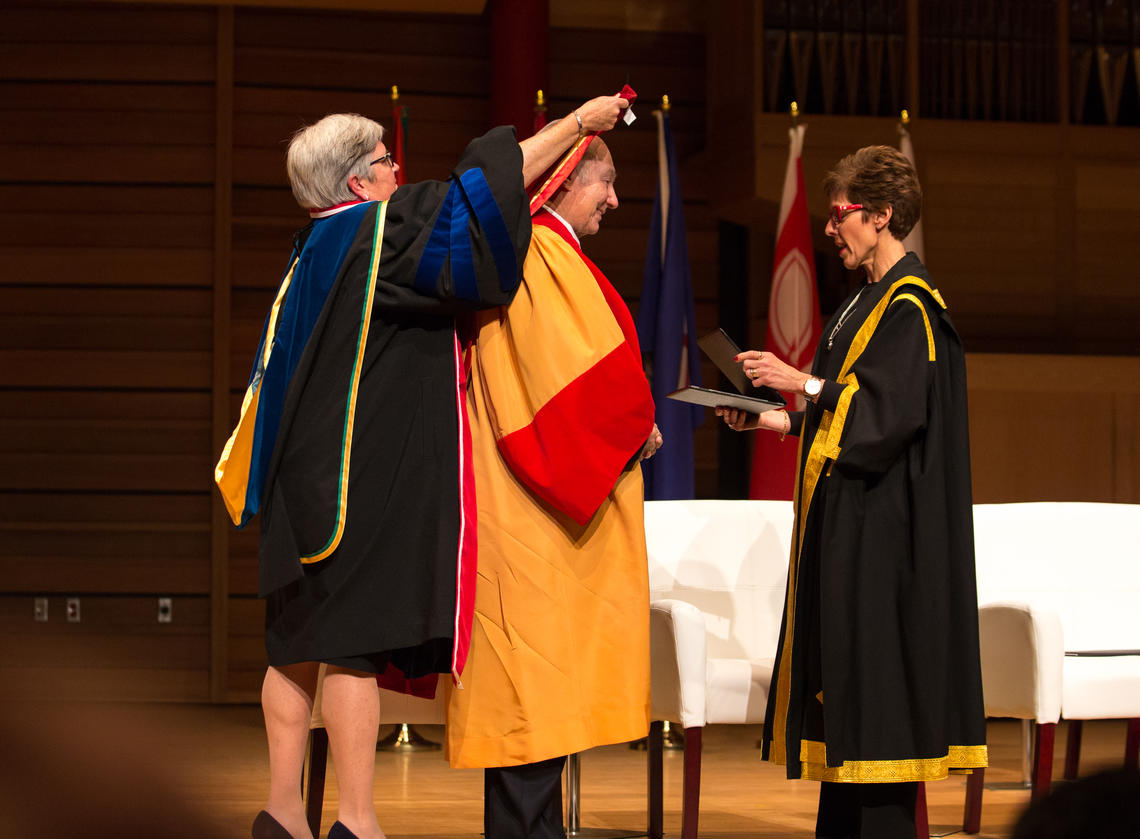 University of Calgary Provost Dru Marshall, left, and Chancellor Deborah Yedlin lead a hooding ceremony conferring an honorary degree on His Highness the Aga Khan.