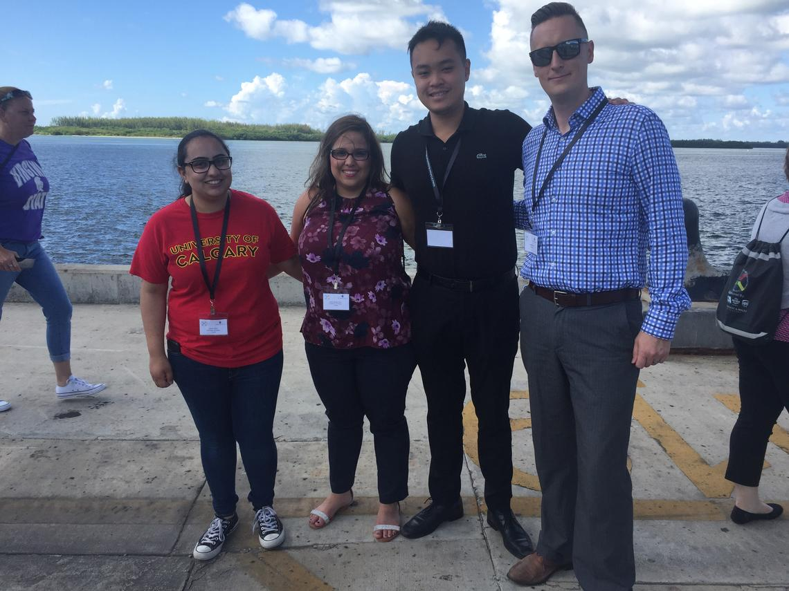 Haskayne instructor Leighton Wilks, far right, poses with Haskayne BComm students at last year's X-Culture Global Symposium in Miami, Fla.