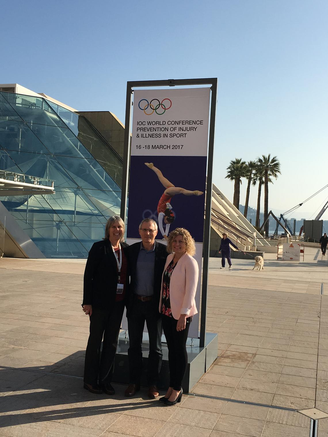 Carolyn Emery, left, Willem Meeuwisse, and Kathryn Schneider at the International Olympic Committee World Conference in Monaco in March.