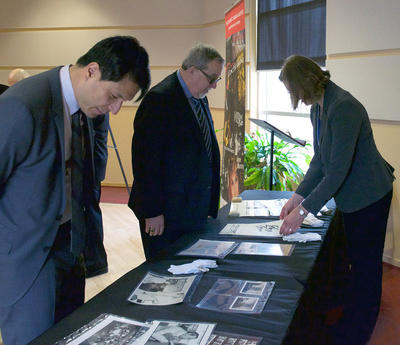 Jeffrey Remedios, president and CEO of Universal Music Canada, left, and Deane Cameron, former president of EMI Music Canada, peruse archival materials from the EMI Music Canada Archive.