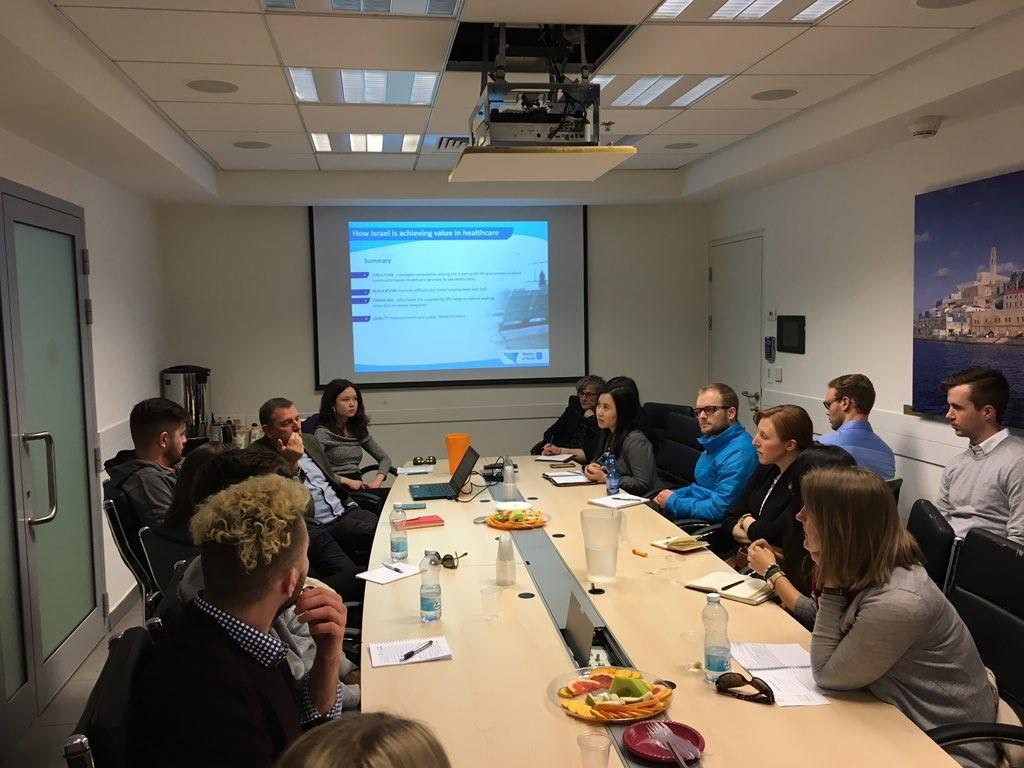 Students interact during a Q-and-A session at Israel's Ministry of Health with Dr. Asher Salmon, on the Israeli health care system.
