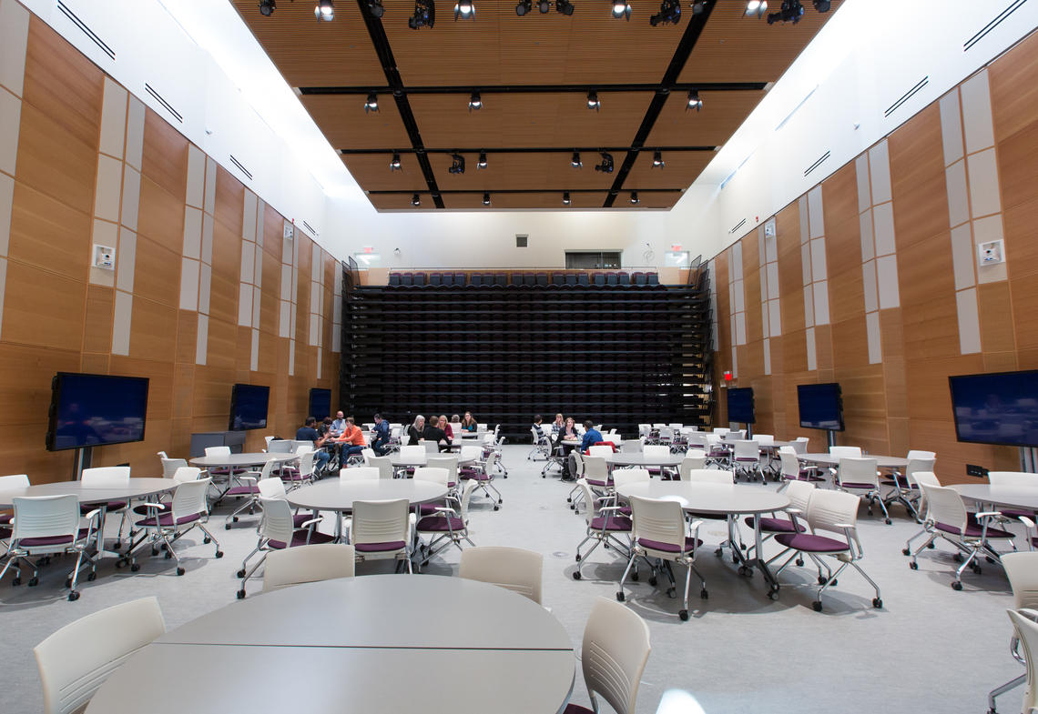 The forum has retractable seating that allows it to convert from a public lecture space to a flat-floor learning space.