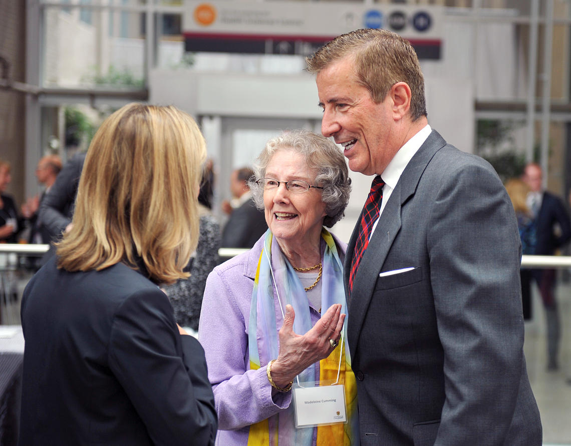 Geoffrey Cumming, right, shares a moment with his mother, Madeleine, during a 2014 event celebrating the largest philanthropic gift in the university's history.