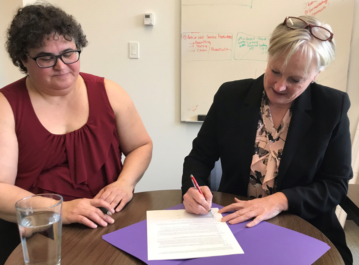 On March 15, Paulette Harrison, AUPE, co-chair, and Rae Ann Aldridge, associate vice-president (risk) and co-chair, officially signed the Terms of Reference of the new JWHSC.