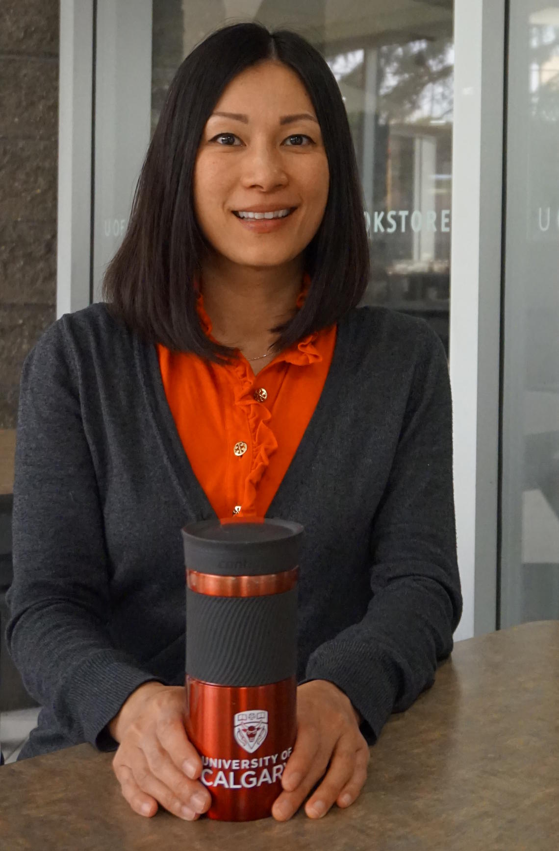 Using the ecofriendly cup she received for presenting at the Women's Leadership Conference is just one way Gina Ko is doing her part to help the environment.