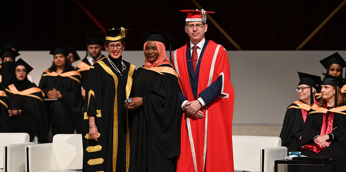 University of Calgary Chancellor Deborah Yedlin and President Ed McCauley flank graduating student Sharifat Makinde, recipient of the Gold Medal for academic achievement in the Bachelor of Nursing program.