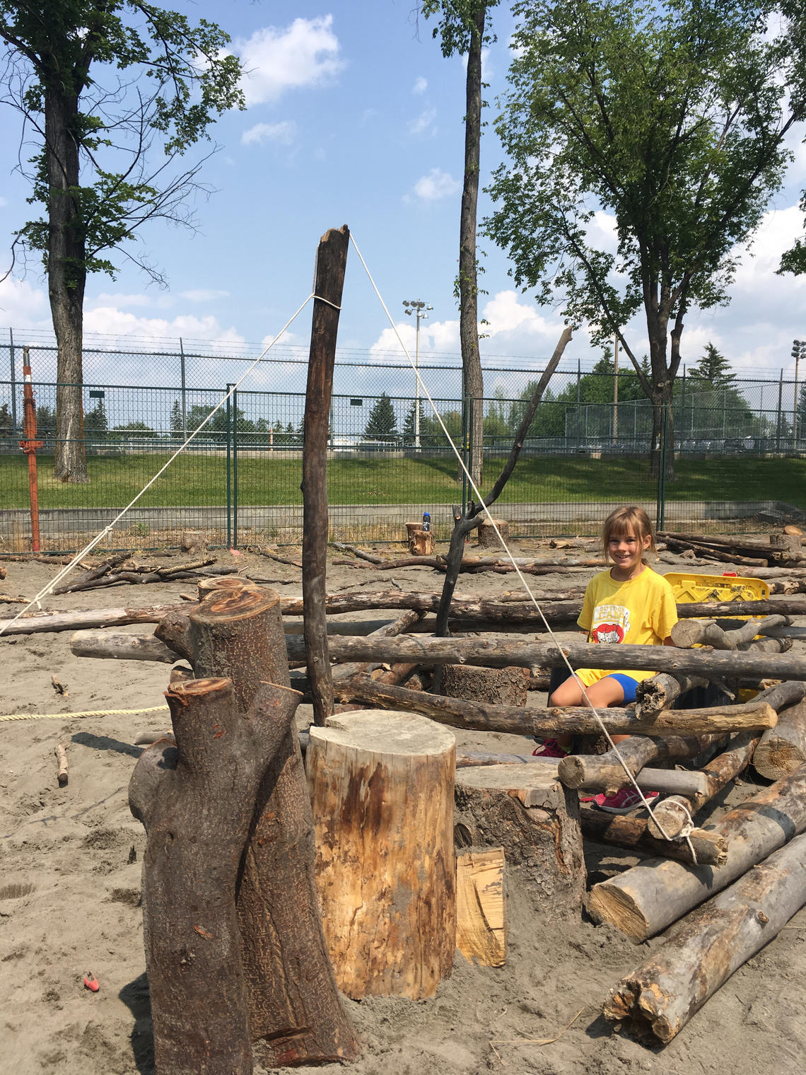 A large variety of building materials are available for summer campers to use their imaginations and interact with nature.