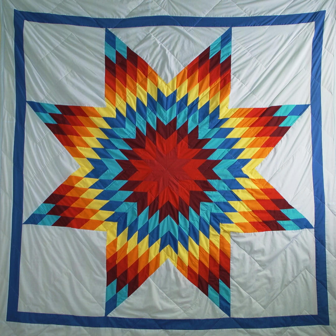 When Whitney Ogle graduated with her first post-secondary degree, her family honoured her with this star quilt after it had been blessed and smudged.