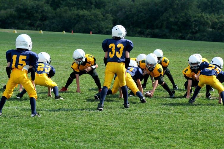 Limiting full-contact play during practices may help prevent concussion in youth football