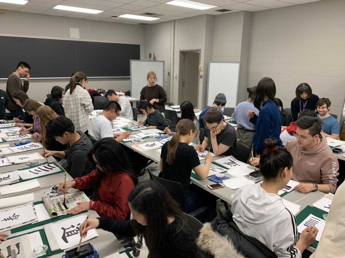 Students learn the art of Japanese Calligraphy