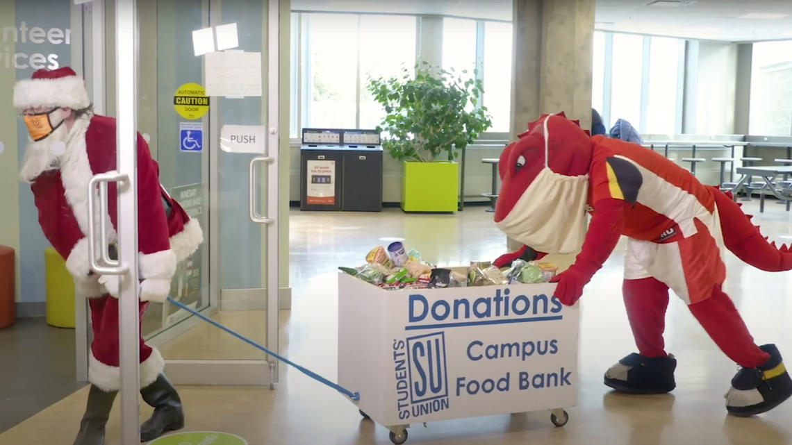 Santa and Rex making donations to the SU