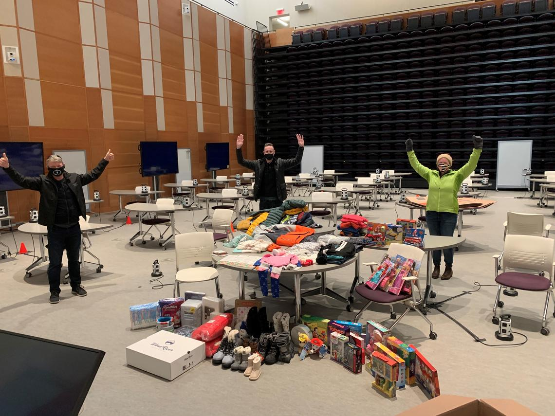 Haskayne EMBA students organize and sort the goods collected for this year's charity challenge.