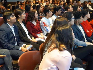 Members of the Ismaili student body watch a live stream of the event in the Dining Centre.