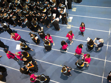 Graduating students, family members, and university leaders take part in convocation ceremonies at the University of Calgary in June 2019.