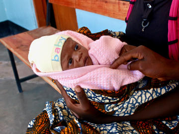 A two-day-old baby awaits a checkup at a health facility in Misunwi District, Tanzania.