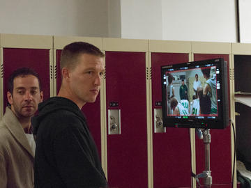Photography Director Guillaume Carlier and director Ted Stenson check on the lack of action on the set.