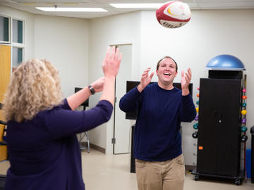 Physio patient throws ball