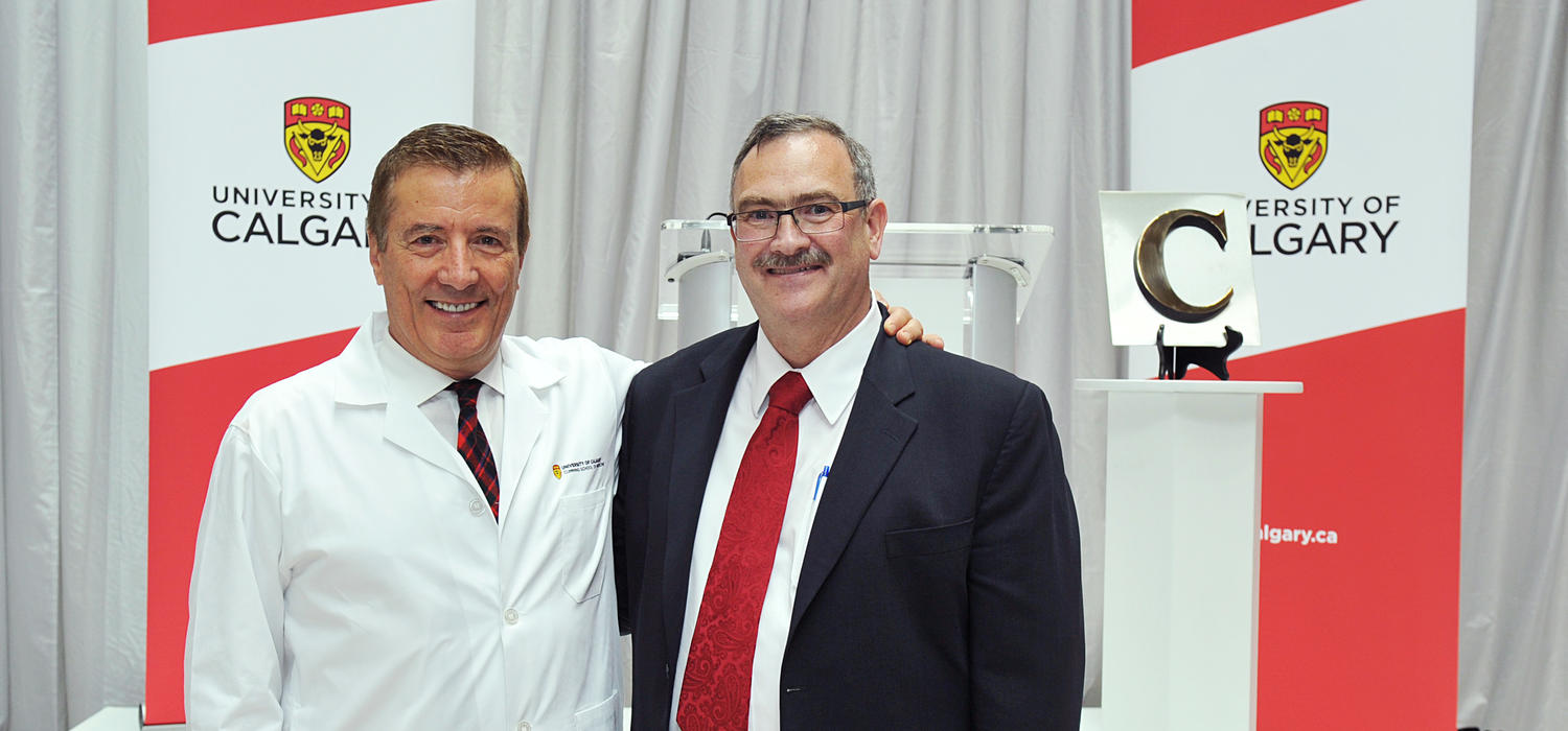 The Cumming School of Medicine is named in honour of Geoffrey Cumming, left, shown with medical school Dean Jon Meddings at the 2014 event announcing the largest donation in the University of Calgary's history. Photos by Jaekyun Im, for the Cumming School of Medicine