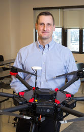 Chris Hugenholtz, an associate professor in the Department of Geography, seen here with his drone technology, is director and head researcher of the newly established Centre For Smart Emissions Sensing Technologies. Photo by Riley Brandt, University of Calgary