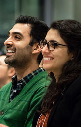 Ashkan Tehrani and Negar Mohammadi look on during the award ceremony at the Innovation4Health Hack Competition.