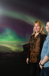 Susan Skone, associate professor in geomatics engineering (left), and Emma Spanswick, associate director of the Aurora Imaging Group, are both working with the Canadian Space Agency to look at how space weather is interfering with GPS signals. Photo by Riley Brandt, University of Calgary