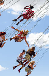 People having fun on a flying swing ride