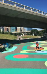"The ""whimsical walk,"" designed in collaboration with University of Calgary students, invites pedestrian participation through creative play opportunities."