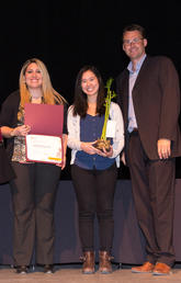 UCalgary's Standardized Waste Bin Project won the 2019 Staff Sustainability Award: Group Leadership. Ana Pazmino, centre left, and Natasha Yee, centre right, accepted the award on the group's behalf from Florentine Strzelczyk and Bart Becker. Photos by Riley Brandt, University of Calgary