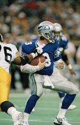 Seattle Seahawks quarterback Rick Mirer (3) is sacked for a seven-yard-loss by Kevin Henry (76) of the Pittsburgh Steelers during the second quarter of their NFL game on Dec. 26, 1993.